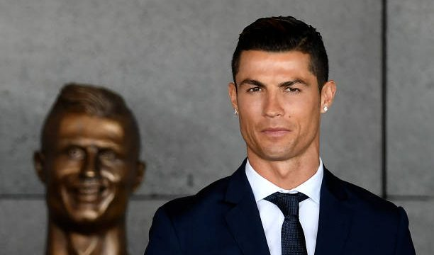 portuguese-footballer-cristiano-ronaldo-stands-past-a-bust-presented-picture-id660064892.jpg